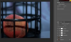 Screenshot of the bruised peach in a black cage in photoshop. Photo shows the layers and editing applied to photo.