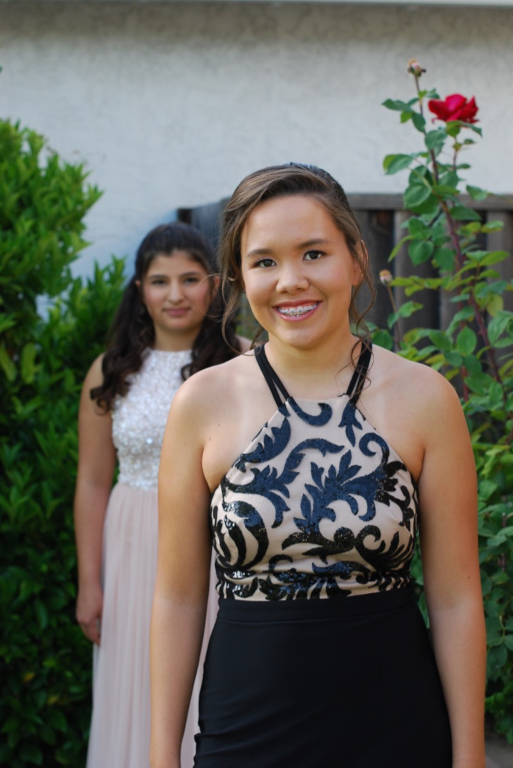 A picture of me in my prom dress with my best friend in the background.