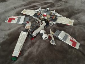 LEGO X-wing in pieces.