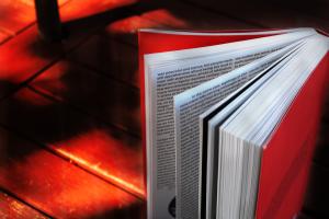 Bird's Eye View of Brightened Red Book With Darkened Background